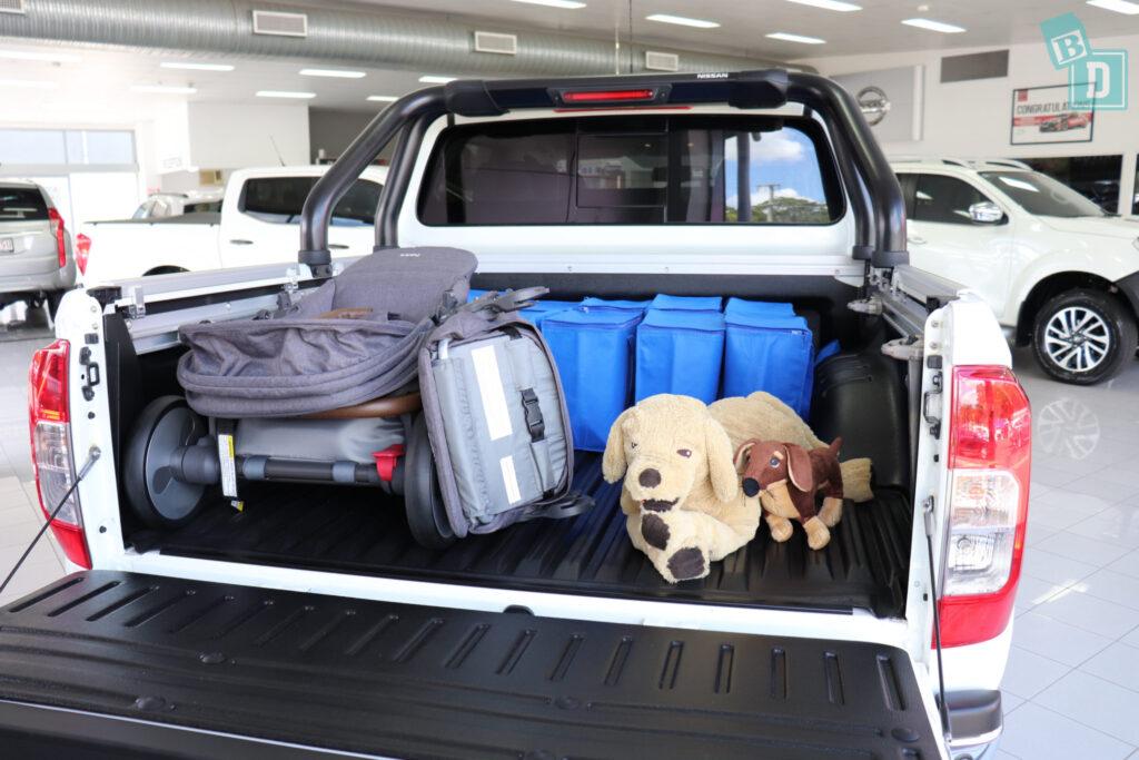 2020 Nissan Navara N-Trek Warrior holding pram stroller, dogs and shopping