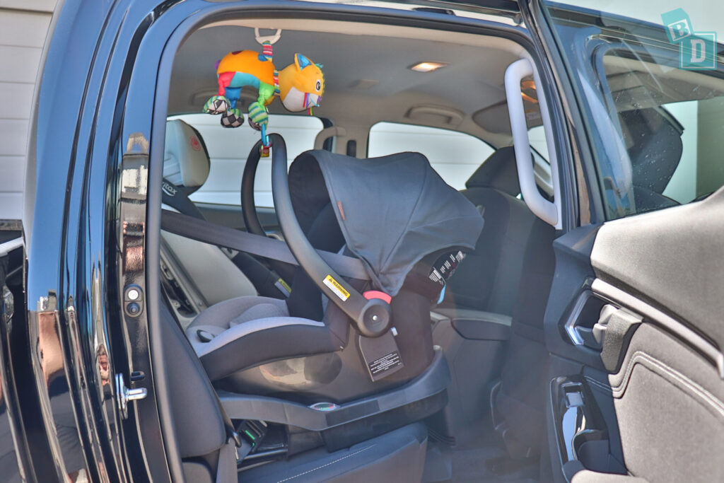 Isuzu D-Max 2021 with rear facing infant capsule and forward facing child seat installed