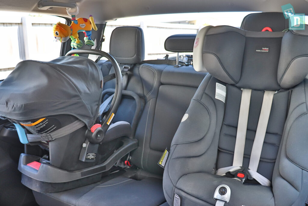 Mazda BT-50 and Isuzu D-Max with rear-facing infant capsule and forward-facing child seat installed