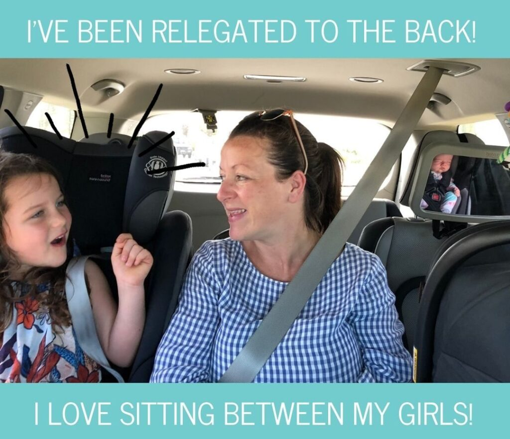Sitting between two child seats in the Kia Carnival