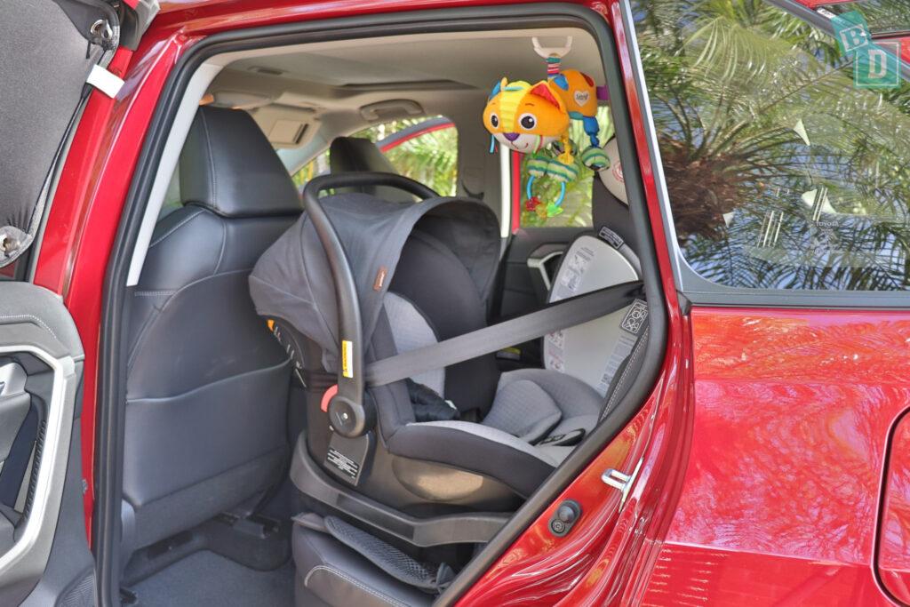 2021 Toyota RAV4 Hybrid Cruiser legroom with rear facing infant capsule child seats installed
