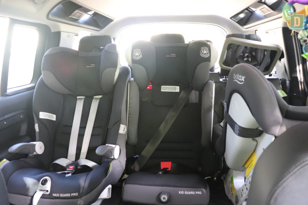 2021 Land Rover Defender 110 with three child seats installed in the second row