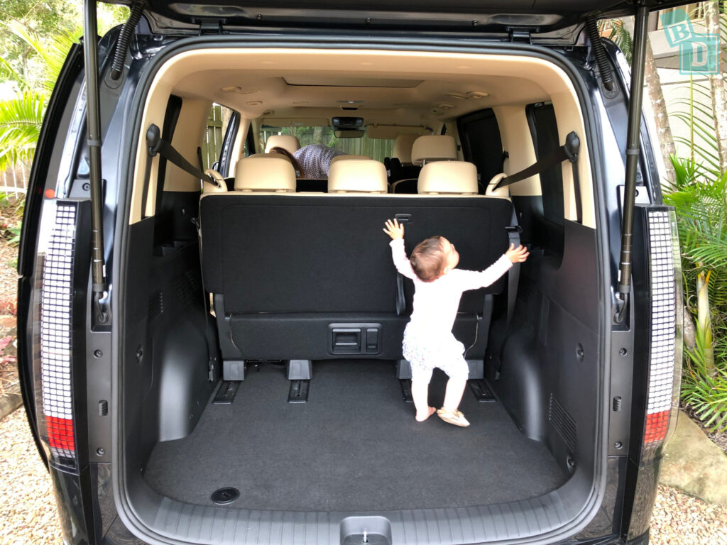 2022 Hyundai Staria Highlander with baby playing in boot